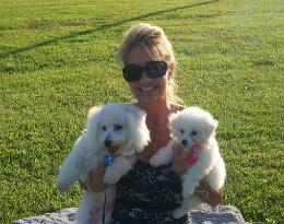 Photo of customer with Bichon dog and Bichon puppy